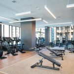 Interior of fitness center with free weights and other exercise machines