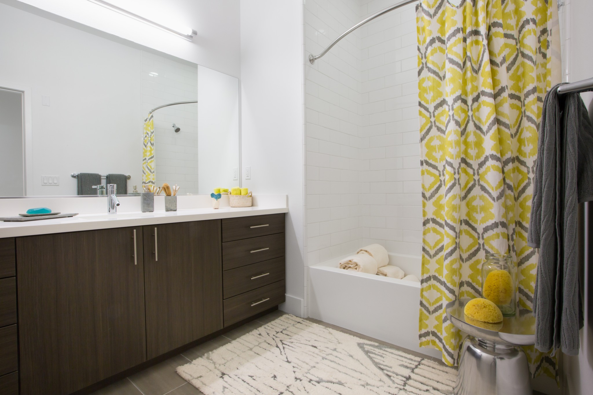 Modern bathroom with a shower over tub and vanity.