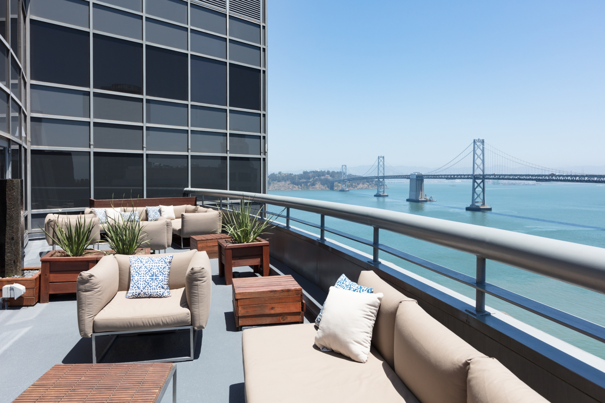 Outdoor deck with a view of the San Francisco Bay Bridge.