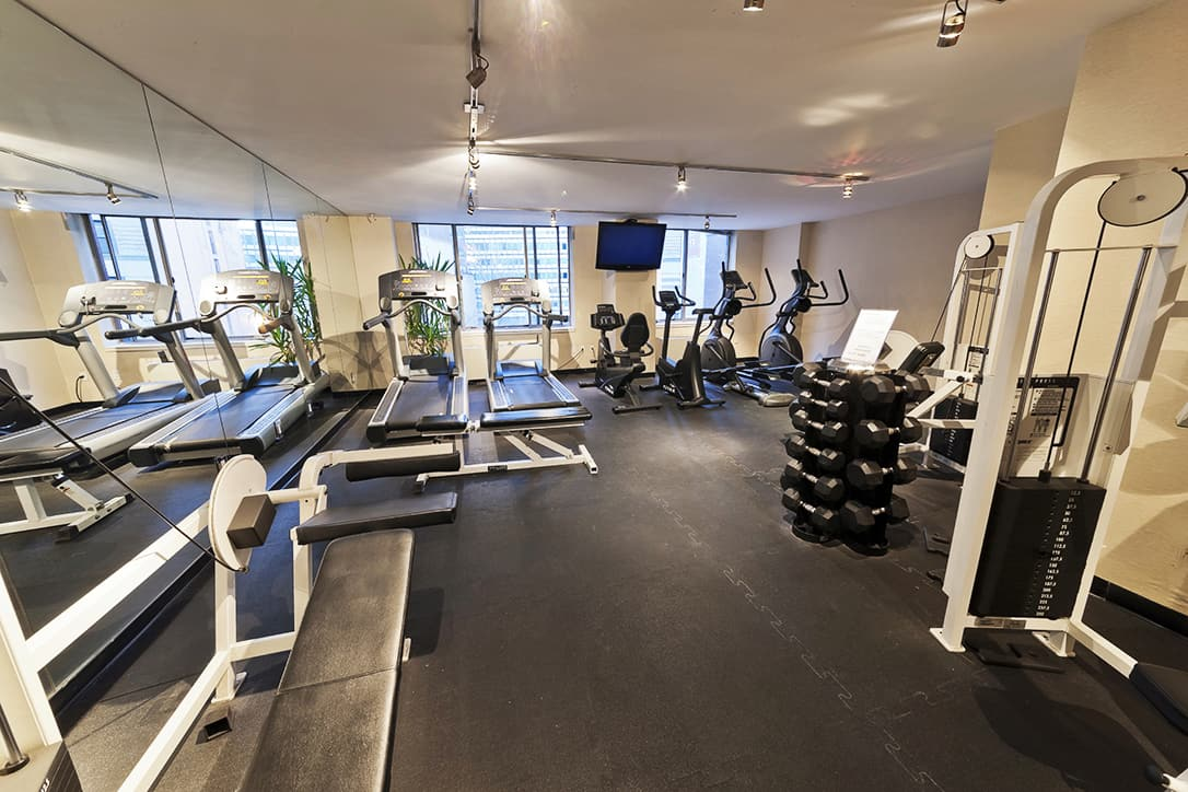 Interior of fitness center with free weights and exercise machines