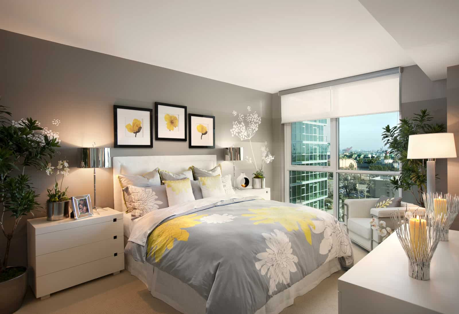 Interior of modern bedroom in a high-rise apartment.