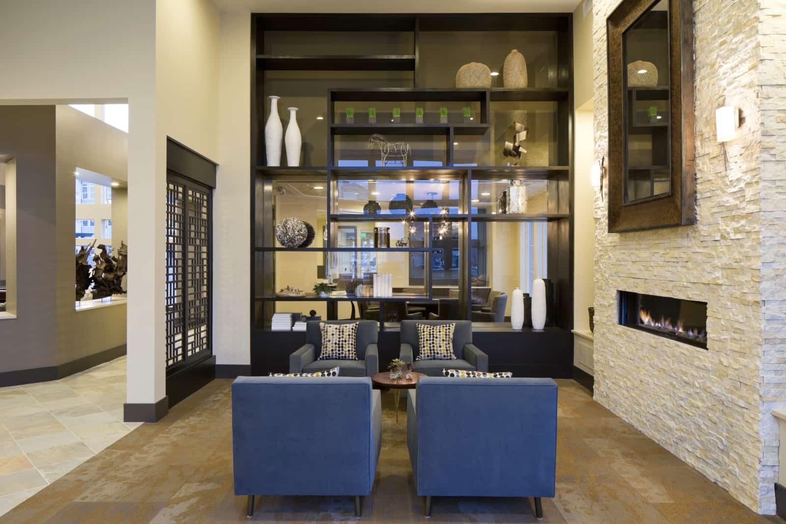 Interior of apartment lobby with modern fireplace and sitting area