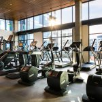 Interior of large fitness center with various exercise machines