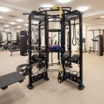Interior of fitness center with free weights and other exercise machines.