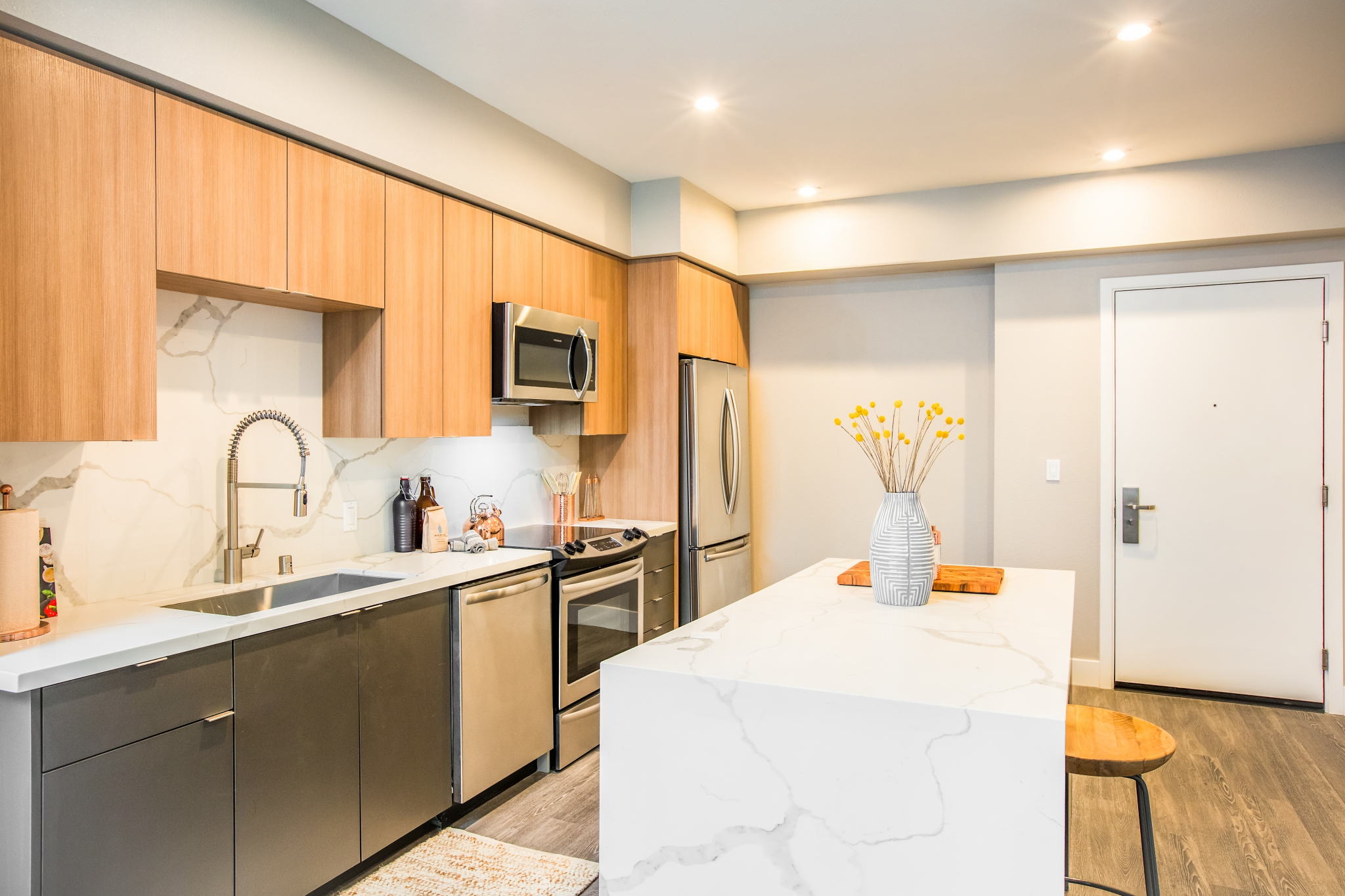 Interior of apartment with open kitchen with marble counters