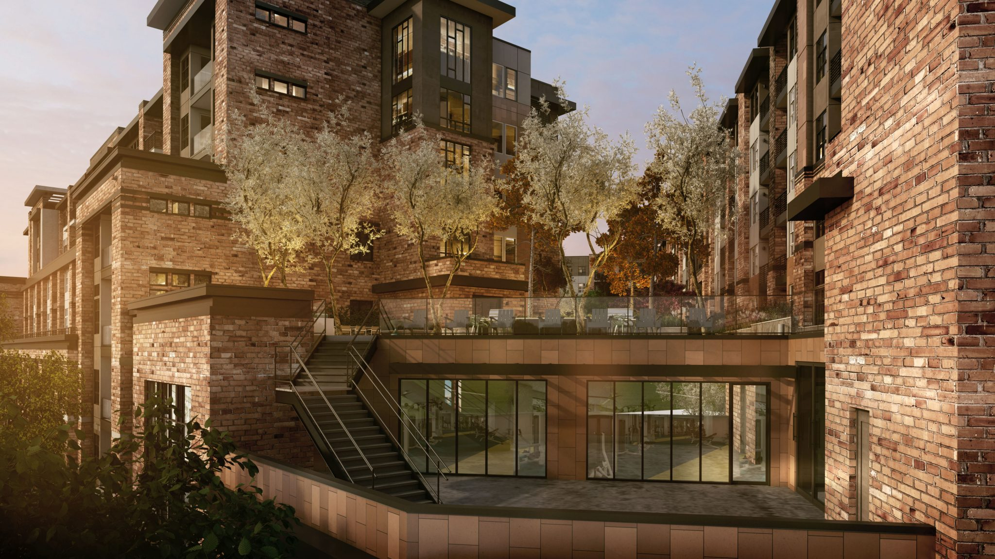 Exterior of brick apartment complex with outdoor area between multistory buildings