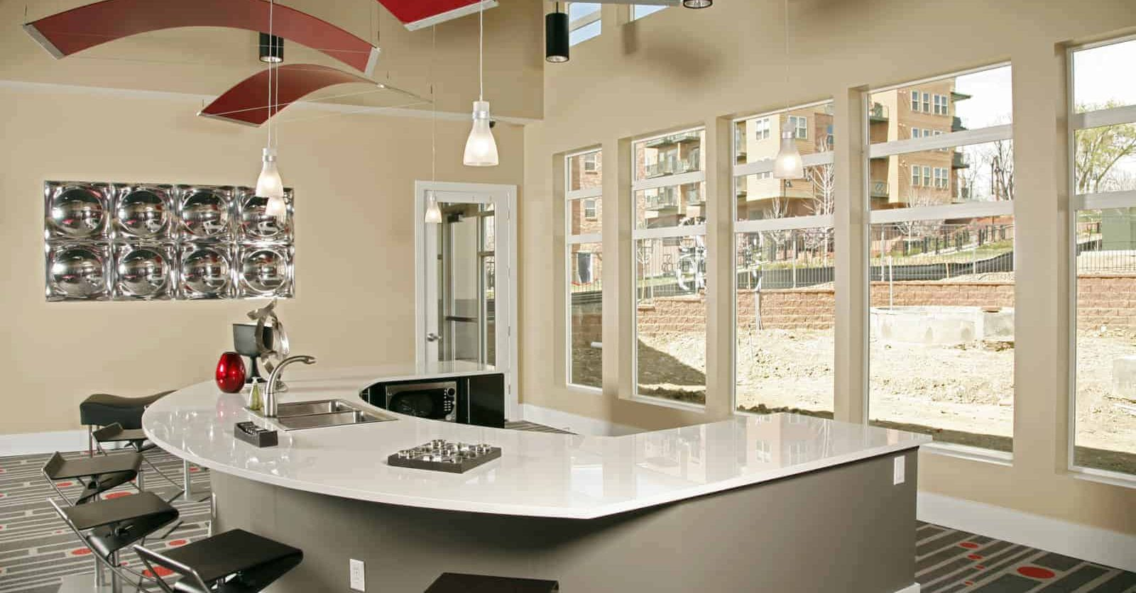Common area kitchen with a u-shaped counter and barstool seating.