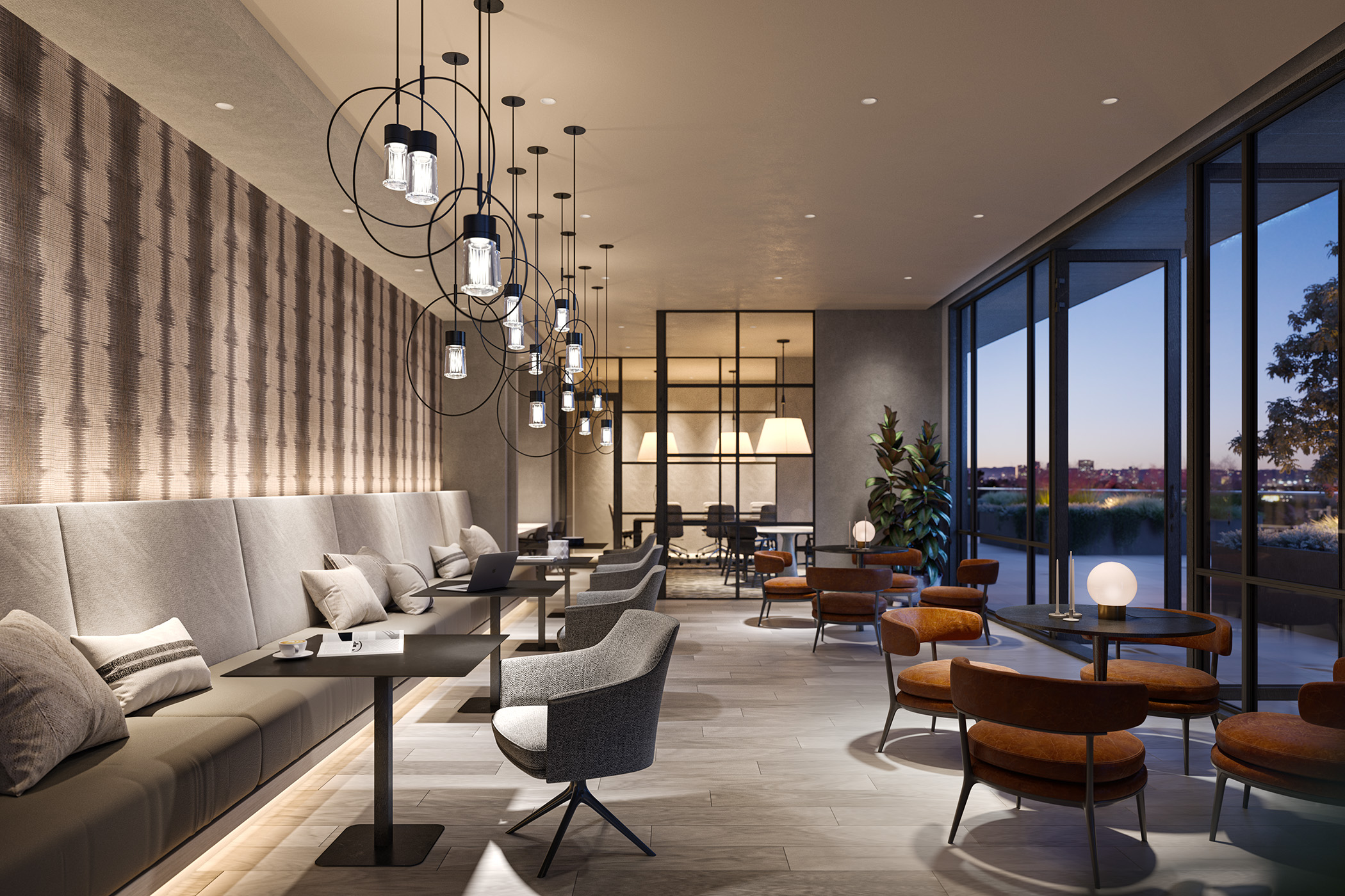 Interior of common meeting area with long bench seating, small tables, chairs, and wall of floor to ceiling windows.