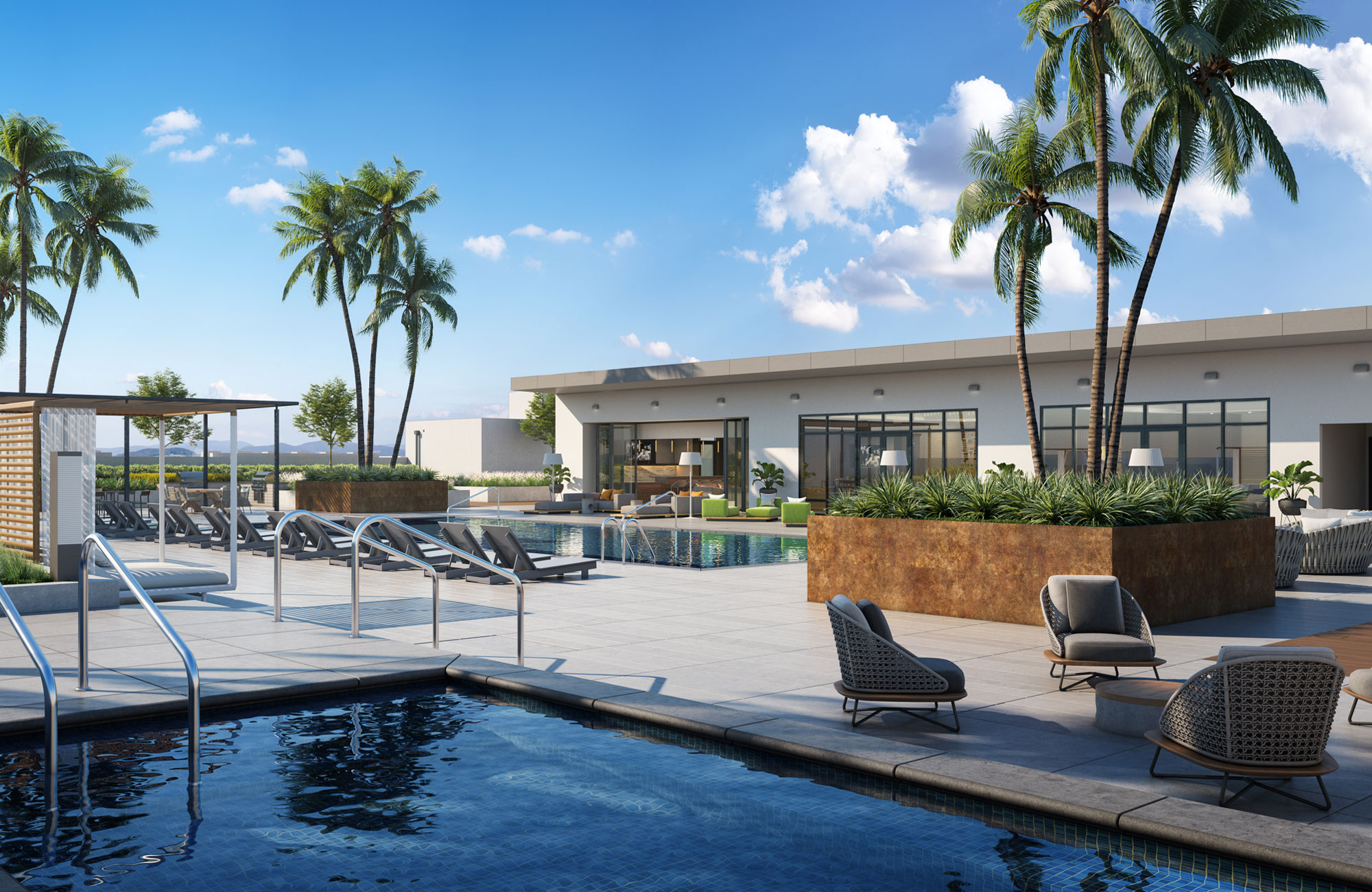 Swimming pool in foreground with second swimming pool, lounge chairs, palm trees in raised planter and modern single-story building in background