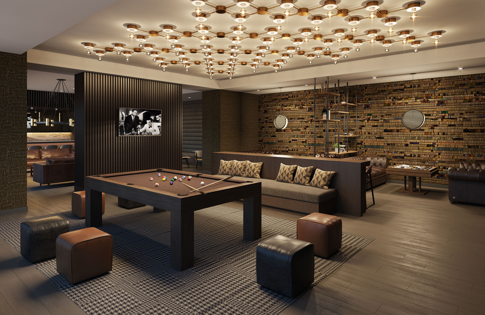 Interior of large game room with pool table and other sitting areas